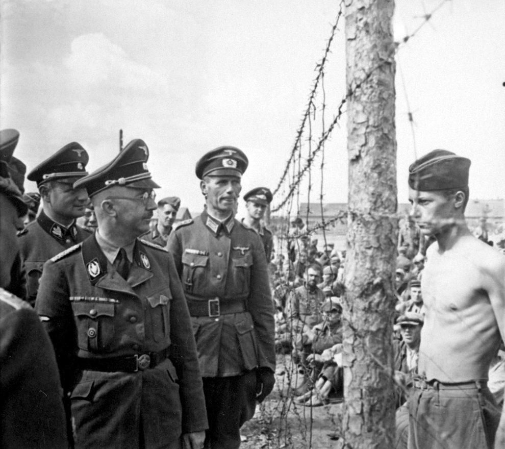 Horace Greasley snuck out, and back into POW camps 200 times. Heinrich Himmler (in glasses) died the day before Greasley was released for good. Coincidence?