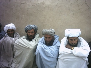 Afghans patiently waiting int he early morning hours while we completed the operation.