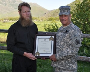 Brig. Gen. Rick Mustion, the adjutant general of the U.S. Army, presents Sgt. Bowe Bergdahl's promotion certificate Bergdahl's father but if he was a POW and out of the DoD system is it legal?