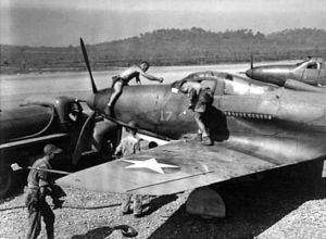 U.S. Army Air Corps crewmen service Bell P-39D Airacobra at Seven Mile airfield, near Port Moresby, New Guinea, in July 1942.