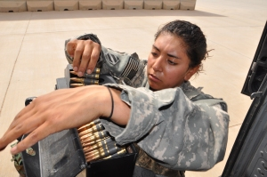 "SPC Crisma Albarran, a BlackHawk door gunner on her second tour in Iraq. The same mechanic that never left a major airbase wouldn't consider her a ""real"" vet because she was a girl."