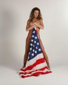 Long before she picked up a flag for being on the ground, Manhart posed with a flag touching the ground.