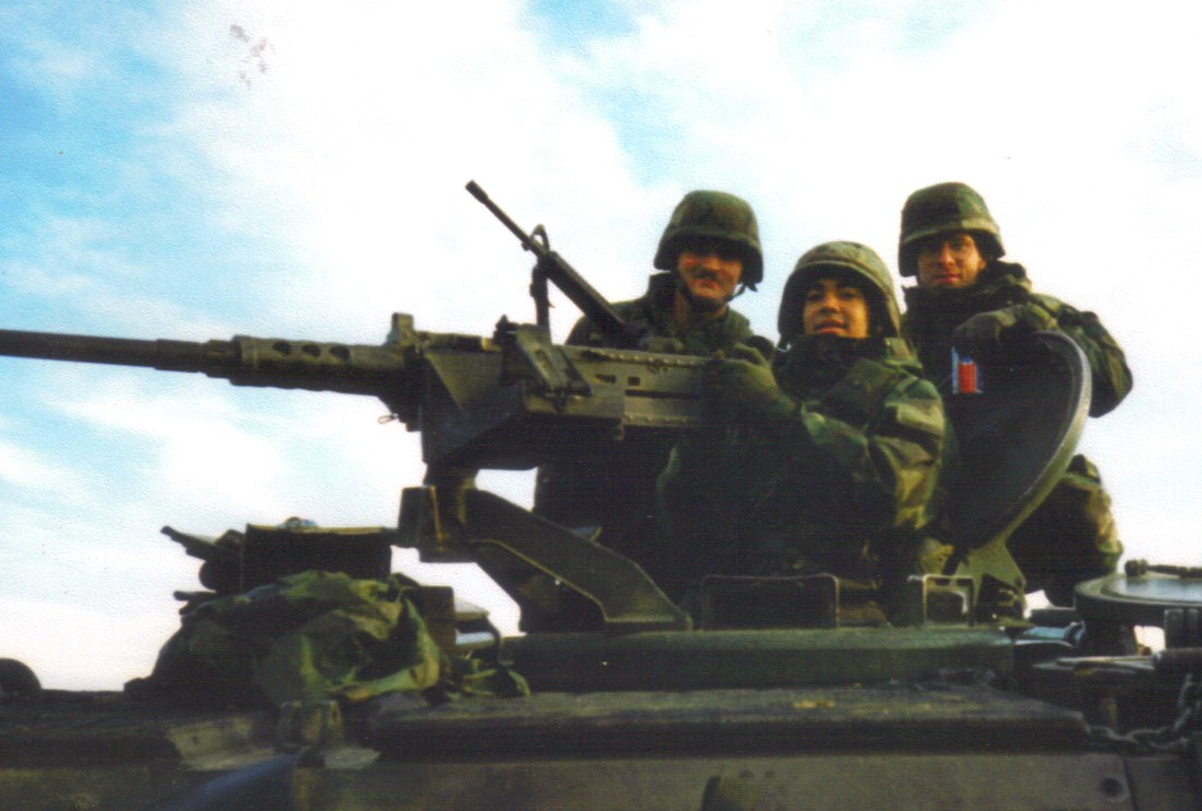 Photo: three soldiers on top of a mechanized mortar vehicles.
